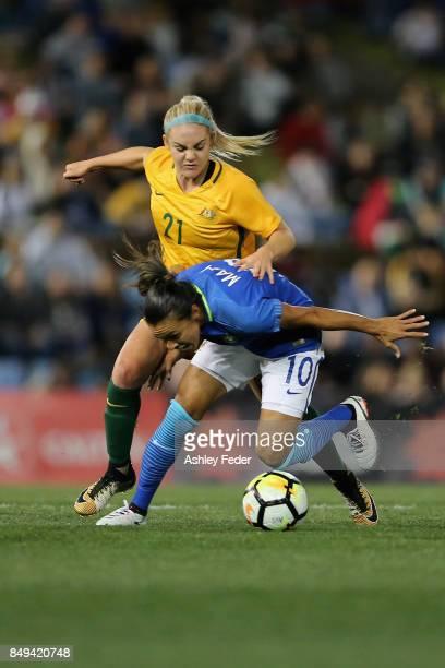 Ellie Carpenter of Australia tackles Marta Vieira da Silva of Brazil during the Women's International match between the Australian Matildas and...