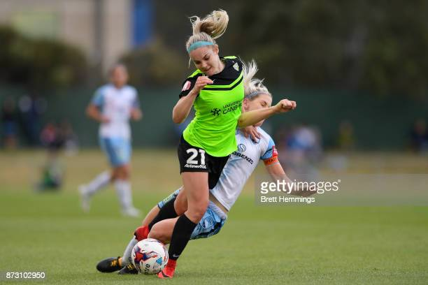 Ellie Carpenter of Canberra is tackled by Caitlin Cooper of Sydney during the round three WLeague match between Canberra United and Sydney FC at...