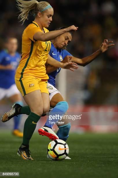 Ellie Carpenter of the Matildas is tackled by Marta Vieira da Silva of Brazil during the Women's International match between the Australian Matildas...