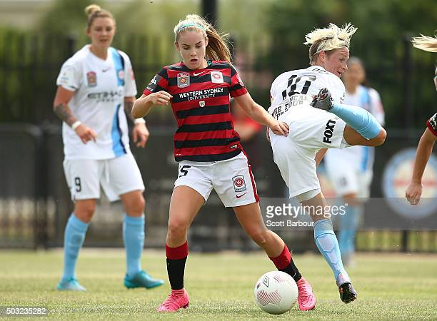 Ellie Carpenter of the Wanderers and Jessica Fishlock of City FC compete for the ball during the round 12 WLeague match between Melbourne City FC and...