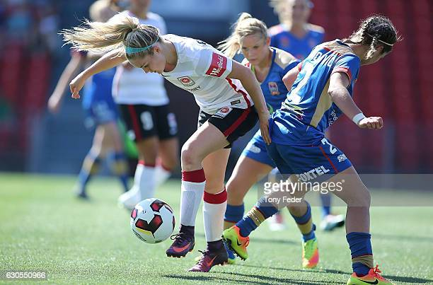Ellie Carpenter of the Wanderers contests the ball with Sophie Nenadovic of the Jets during the round eight WLeague match between Newcastle and...