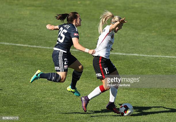 Ellie Carpenter of the Wanderers is challenged by Kariah White of the Victory during the round six WLeague match between Melbourne Victory and...