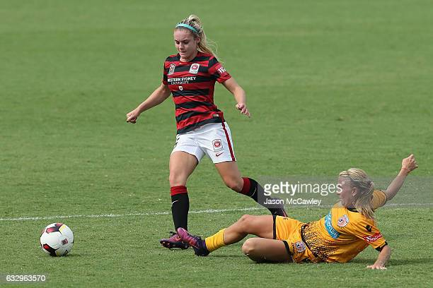 Ellie Carpenter of the Wanderers is challenged by Kim Carroll of the Glory during the round 14 WLeague match between the Western Sydney Wanderers and...