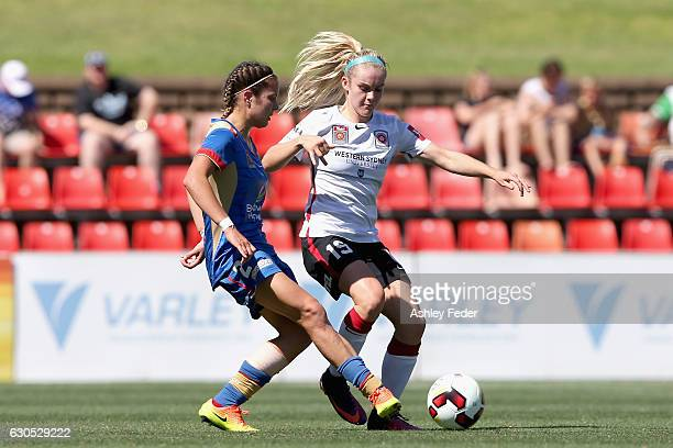 Ellie Carpenter of the Wanderers is contested by Clare Wheeler of the Jets during the round eight WLeague match between Newcastle and Western Sydney...