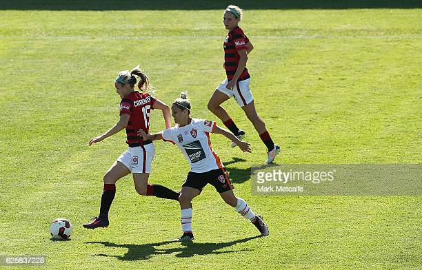 Ellie Carpenter of the Wanderers takes on Katrina Goryy of the Roar during the round four WLeague match between the Western Sydney Wanderers and the...