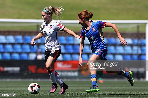 Ellie Carpenter of the Wanderes is tackled by Clare Wheeler of the Jets during the round eight WLeague match between Newcastle and Western Sydney at...