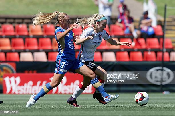 Ellie Carpenter of the Wanderes is tackled by Gema Simon of the Jets during the round eight WLeague match between Newcastle and Western Sydney at...