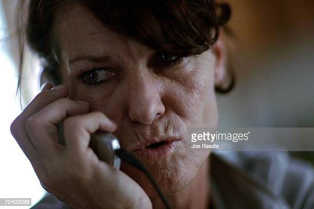 Ellie Cousino talks to a Federal Emergency Management Agency agent on the phone for assistance November 3 2006 in Punta Gorda Florida Cousino has...