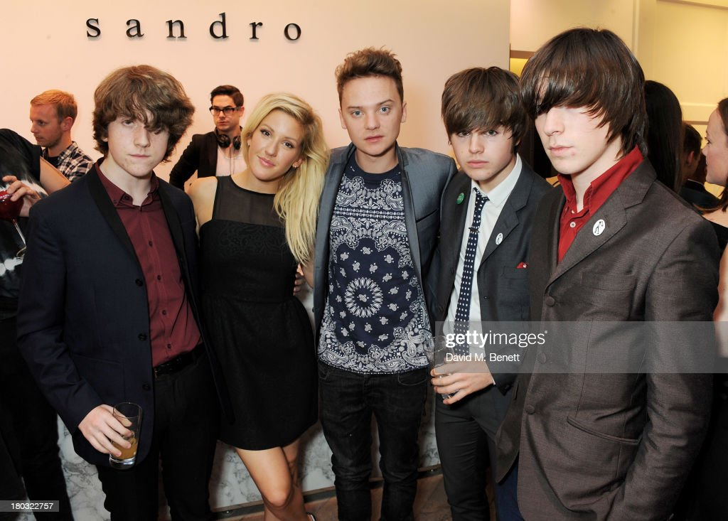 Ellie Goulding and Conor Maynard pose with Pete O'Hanlon Josh McClorey and Ross Farrelly of The Strypes at the Sandro London flagship store launch in...