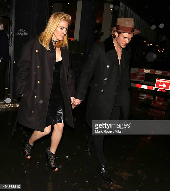 Ellie Goulding and Dougie Poynter leaving West ThirtySix restaurant on October 29 2015 in London England
