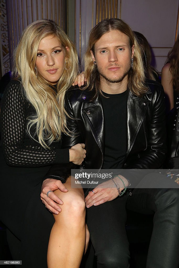 <a gi-track='captionPersonalityLinkClicked' href=/galleries/search?phrase=Ellie+Goulding&family=editorial&specificpeople=6389309 ng-click='$event.stopPropagation()'>Ellie Goulding</a> and her boyfriend <a gi-track='captionPersonalityLinkClicked' href=/galleries/search?phrase=Dougie+Poynter&family=editorial&specificpeople=214057 ng-click='$event.stopPropagation()'>Dougie Poynter</a> attend the Versace show as part of Paris Fashion Week Haute Couture Spring/Summer 2015 on January 25, 2015 in Paris, France.