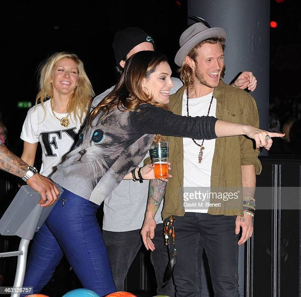 Ellie Goulding Kelly Brook and Dougie Poynter bowl at the launch party for Brooklyn Bowl at the 02 Arena on January 16 2014 in London England