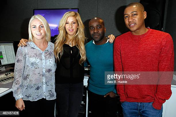 Ellie Goulding poses for pictures with Charlie Hedges Melvin Odoom and Rickie Haywood Williams during a visit to Kiss FM on January 29 2014 in London...