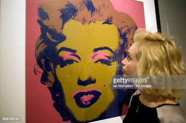 Ellie Manwell views a silk screen print of Marilyn Monroe by Andy Warhol hung at the Dulwich Picture Gallery ahead of a major new exhibition of the...