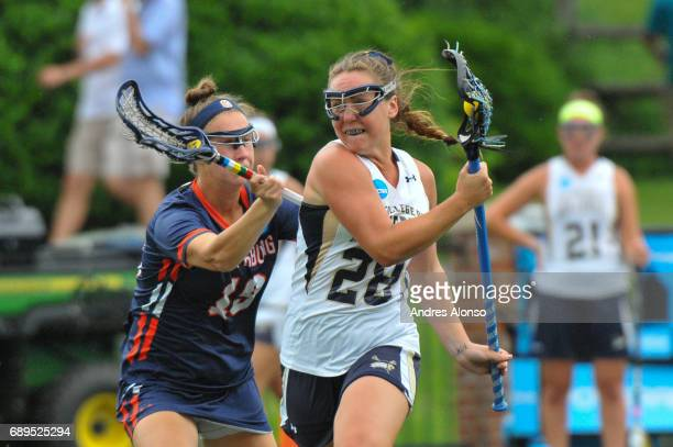 Ellie O'Neil of College of New Jersey defends Elsie Wagner of Gettysburg College during the Division III Women's Lacrosse Championship held at Kerr...