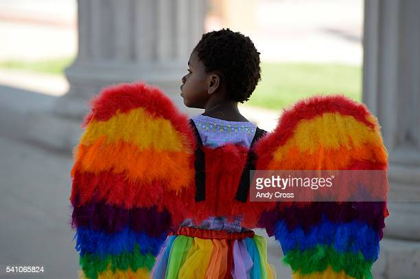 Ellie Ozbayrak sports rainbow wings at the annual PrideFest celebration at Civic Center Park June 18 2016