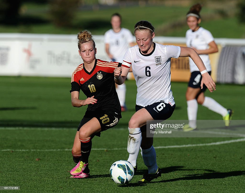 Ellie Stewart of England with Janina Meissner of Germany during the Women's International Friendly match between England Under 19 Women and Germany Under 19 Women at St George's Park on September 22, 2013 in Burton upon Trent, England.