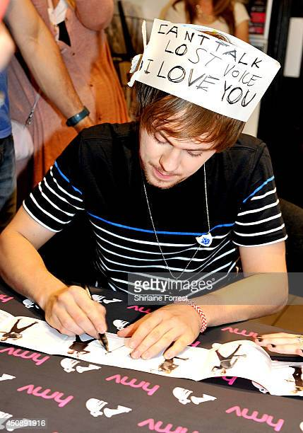 Ellington Ratliff of R5 signs copies of their new album 'Louder' at HMV Manchester on June 19 2014 in Manchester England