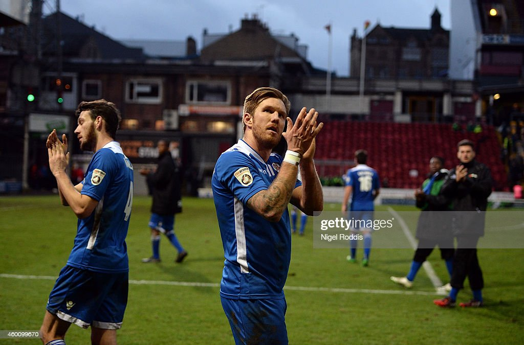 Elliot Bradbrook (C) of Dartford applauds the crowd after the FA Cup Second Round football match between Bradford City and Dartford at Coral Windows Stadium, Valley Parade on December 7, 2014 in Bradford, England.