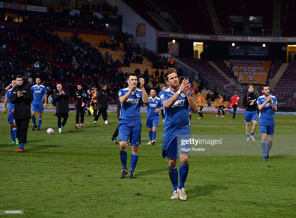 Elliot Bradbrook (C) of Dartford leads the applause to the crowd after the FA Cup Second Round football match between Bradford City and Dartford at Coral Windows Stadium, Valley Parade on December 7, 2014 in Bradford, England.