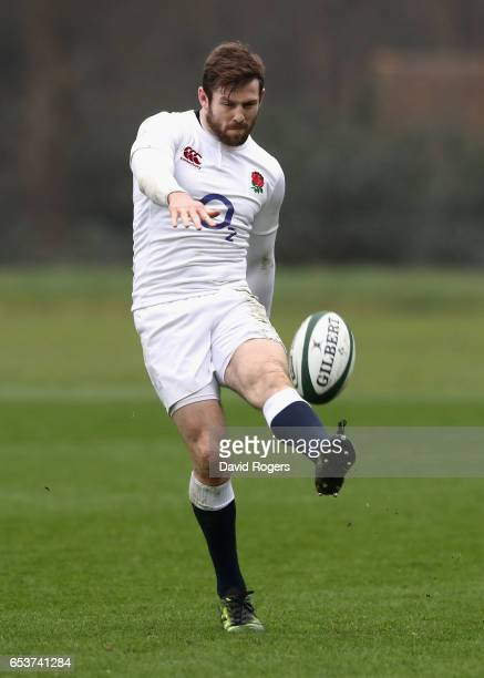 Elliot Daly kicks the ball upfield during the England training session held at Pennyhill Park on March 16 2017 in Bagshot England