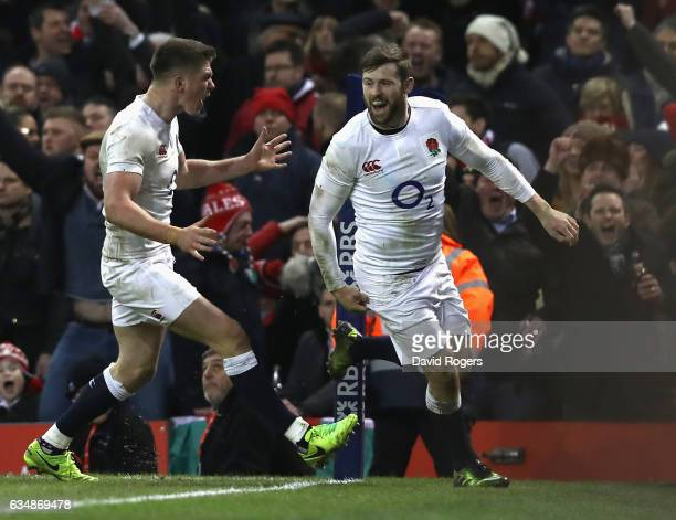 Elliot Daly of England celebrates with team mate Owen Farrell after scoring the match winning try during the RBS Six Nations match between Wales and...
