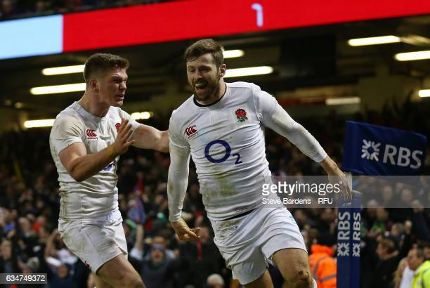 Elliot Daly of England is congratulated by teammate Owen Farrell of England after scoring the match winning try during the RBS Six Nations match...