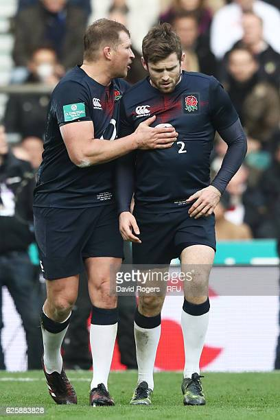 Elliot Daly of England is consoled by Dylan Hartley of England after being shown the red card during the Old Mutual Wealth Series match between...