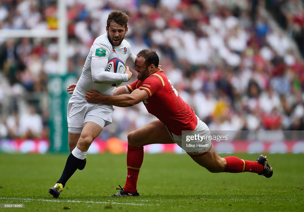<a gi-track='captionPersonalityLinkClicked' href=/galleries/search?phrase=Elliot+Daly&family=editorial&specificpeople=6751828 ng-click='$event.stopPropagation()'>Elliot Daly</a> of England is tackled by <a gi-track='captionPersonalityLinkClicked' href=/galleries/search?phrase=Jamie+Roberts&family=editorial&specificpeople=3530992 ng-click='$event.stopPropagation()'>Jamie Roberts</a> of Wales during the Old Mutual Wealth Cup between England and Wales at Twickenham Stadium on May 29, 2016 in London, England.