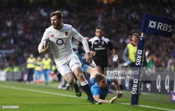 Elliot Daly of England runs in his team's third try during the RBS Six Nations match between England and Italy at Twickenham Stadium on February 26...