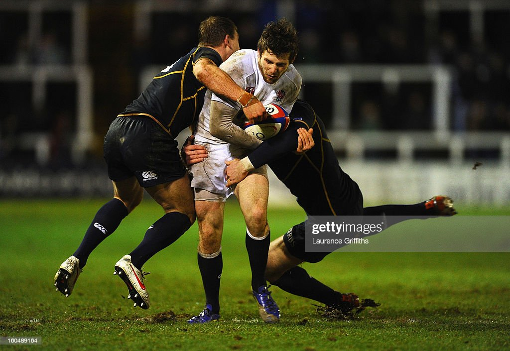 Elliot Daly of England Saxons is tackled by Greig Tonks of Scotland during the International Friendly match between England Saxons and Scotland A at Kingston Park on February 1, 2013 in Newcastle upon Tyne, England.