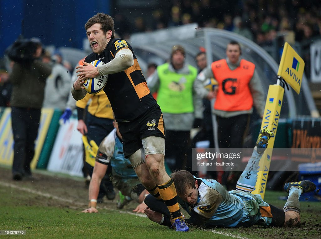 Elliot Daly of London Wasps evades the tackle of <a gi-track='captionPersonalityLinkClicked' href=/galleries/search?phrase=Stephen+Myler&family=editorial&specificpeople=2335052 ng-click='$event.stopPropagation()'>Stephen Myler</a> of Northampton Saints on his way to scoring his team's second try during the Aviva Premiership match between London Wasps and Northampton Saints at Adams Park on March 23, 2013 in High Wycombe, England.