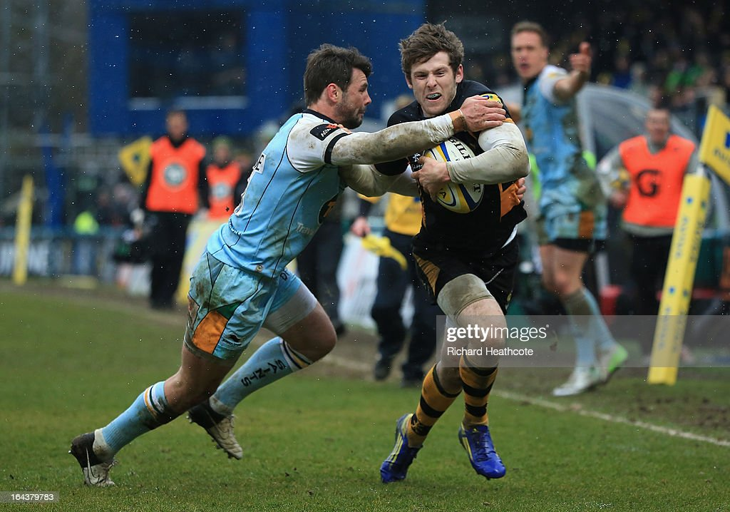Elliot Daly of London Wasps shrugs off the tackle of <a gi-track='captionPersonalityLinkClicked' href=/galleries/search?phrase=Ben+Foden&family=editorial&specificpeople=542798 ng-click='$event.stopPropagation()'>Ben Foden</a> of Northampton Saints on his way to scoring his team's second try during the Aviva Premiership match between London Wasps and Northampton Saints at Adams Park on March 23, 2013 in High Wycombe, England.