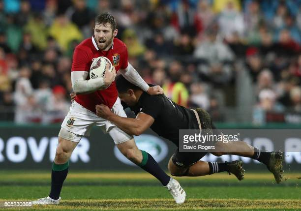 Elliot Daly of the Lions is tackled by Anton LienertBrown during the match between the New Zealand All Blacks and the British Irish Lions at Westpac...