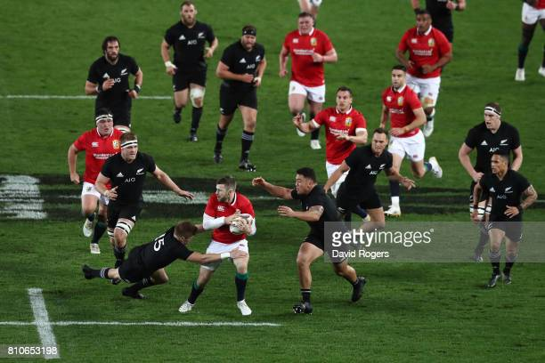 Elliot Daly of the Lions is tackled by Jordie Barrett of the All Blacks during the third test match between the New Zealand All Blacks and the...