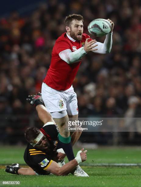 Elliot Daly of the Lions juggles the ball as he is tackled by Lachlan Boshier of the Chiefs during the 2017 British Irish Lions tour match between...