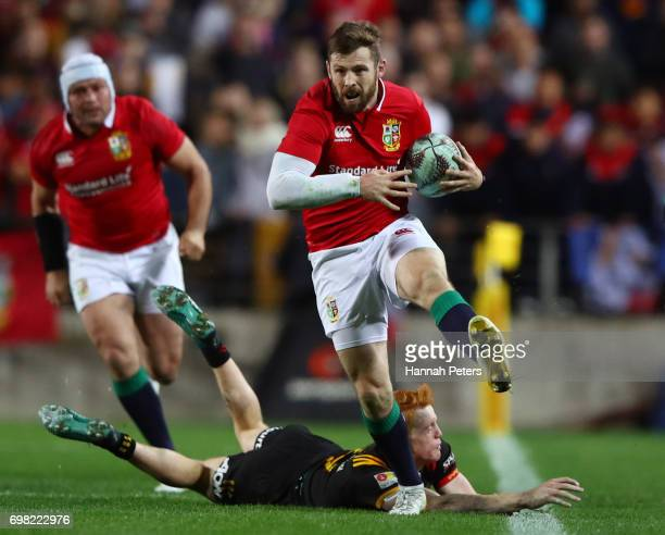 Elliot Daly of the Lions skipsthrough the tackle from Finlay Christie of the Chiefs during the 2017 British Irish Lions tour match between the Chiefs...