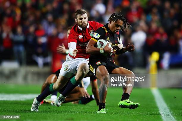 Elliot Daly of the Lions tackles Johnny Faauli of the Chiefs during the match between the Chiefs and the British Irish Lions at Waikato Stadium on...