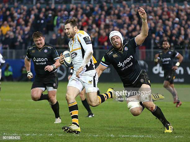 Elliot Daly of Wasps breaks away from Dave Attwood and David Wilson to score a try during the European Rugby Champions Cup match between Bath and...