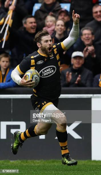 Elliot Daly of Wasps celebrates scoring their fourth try during the Aviva Premiership match between Wasps and Saracens at The Ricoh Arena on May 6...