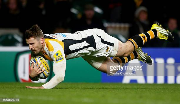 Elliot Daly of Wasps dives over to score a try during the Aviva Premiership match between London Irish and Wasps at Twickenham Stadium on November 28...