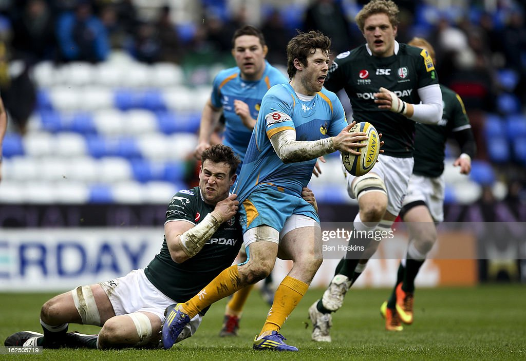 Elliot Daly of Wasps is tackled by Davy McGregor of London Irish during the Aviva Premiership match between London Irish and London Wasps at the Madejski Stadium on February 24, 2013 in Reading, England.