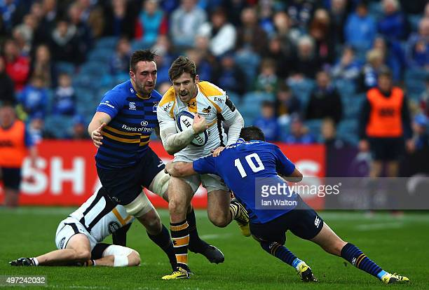 Elliot Daly of Wasps is tackled by Johnny Sexton of Leinster during the European Rugby Champions Cup match between Leinster Rugby and Wasps at the...