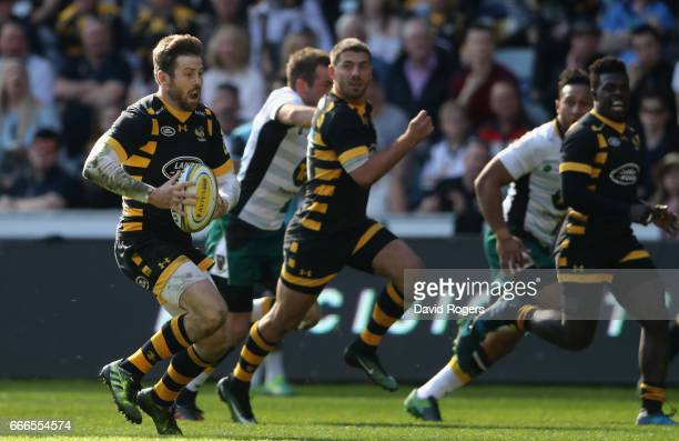 Elliot Daly of Wasps runs with the ball during the Aviva Premiership match between Wasps and Northampton Saints at The Ricoh Arena on April 9 2017 in...