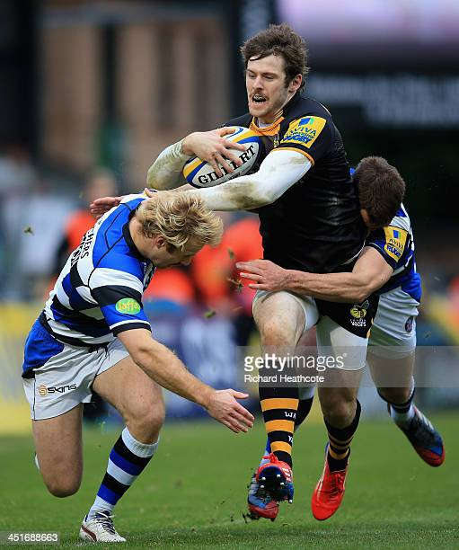 Elliot Daly of Wasps shakes off Nick Abendanon of Bath during the Aviva Premiership match between London Wasps and Bath Rugby at Adams Park on...