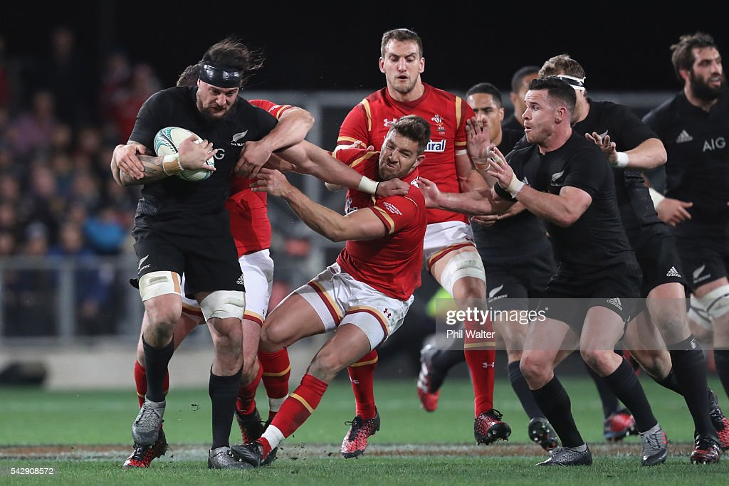 Elliot Dixon of the All Blacks is tackled during the International Test match between the New Zealand All Blacks and Wales at Forsyth Barr Stadium on June 25, 2016 in Dunedin, New Zealand.