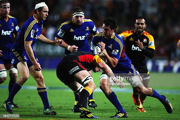 Elliot Dixon of the Highlanders charges forward during the round six Super Rugby match between the Chiefs and the Highlanders at Waikato Stadium on...