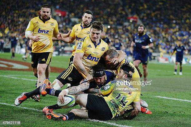 Elliot Dixon of the Highlanders dives over to score a try during the Super Rugby Final match between the Hurricanes and the Highlanders at Westpac...