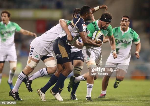 Elliot Dixon of the Highlanders is tackled by Tevita Kuridrani of the Brumbies during the round five Super Rugby match between the Brumbies and the...