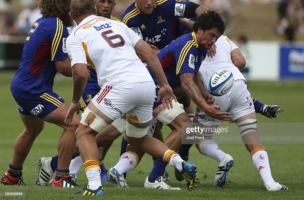 Elliot Dixon of the Highlanders struggles to contol the ball during the 2013 Super Rugby pre-season friendly match between the Chiefs and the Highlanders at Owen Delany Park, Taupo on February 2, 2013 in Taupo, New Zealand.